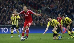 Bayern's Arjen Robben of the Netherlands scores during the Champions League Final soccer match between Borussia Dortmund and Bayern Munich at Wembley Stadium in London, Saturday May 25, 2013.   (AP Photo/Matt Dunham)
